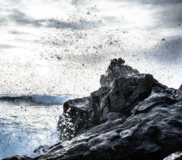 image of a rocky peak overlooking ocean