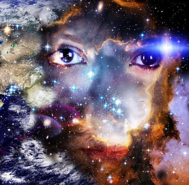 A the universe superimposed over a human face