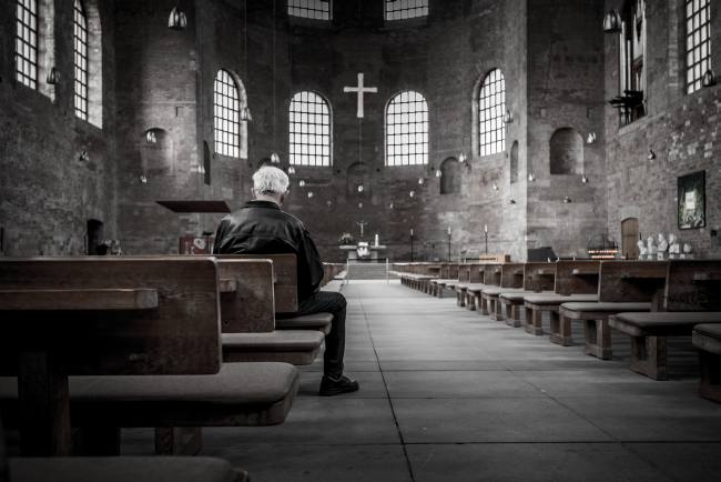man sitting in a church