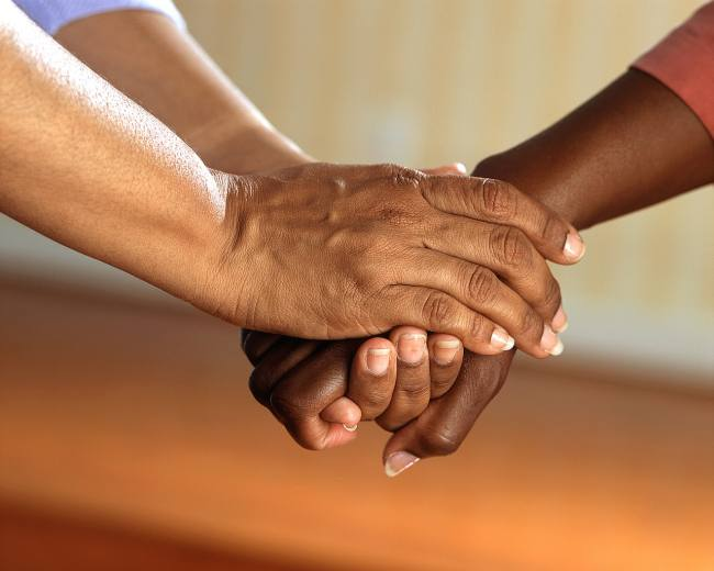two people, clasped hands