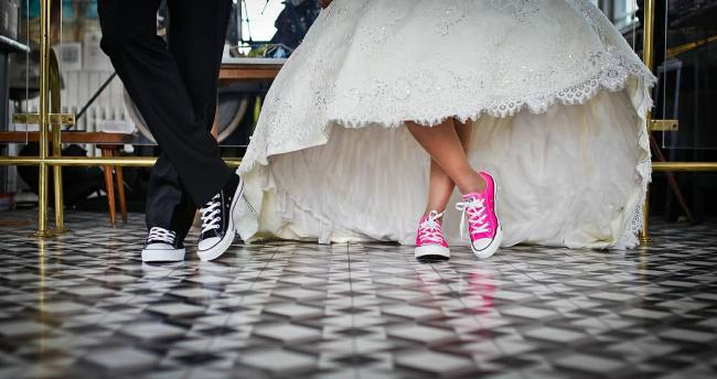 bridal couple wearing sneakers
