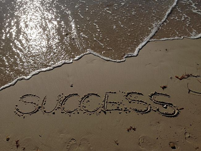 the word success written in the sand