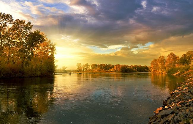image of a river bathed with the golden hue of late evening